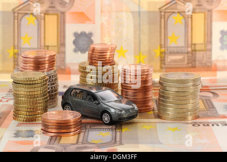 Banknotes, coins, euro, symbolic image for acquisition costs, maintenance of a car - Stock Photo