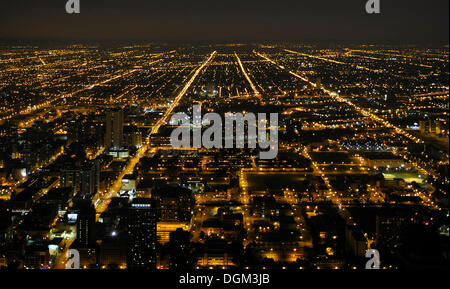 Night shot, street grid located in the west of Chicago, Illinois, United States of America, USA - Stock Photo