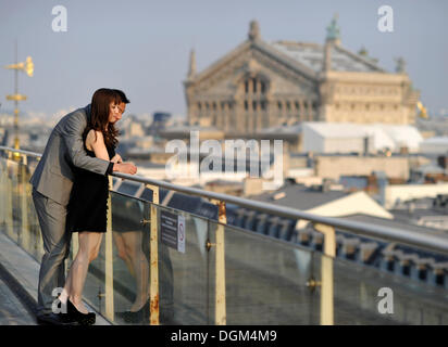 Couple and view from a viewing platform on the Opéra Palais Garnier opera house, Paris, France, Europe - Stock Photo
