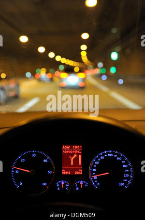 Night, poor visibility in a tunnel, tachometer with navigation display, VW Golf, illuminated, while driving - Stock Photo