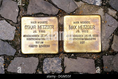 Stolpersteine, stumbling blocks as memorial plaques to commemorate Jewish victims of Nazism in Berlin, Sopienstrasse - Stock Photo