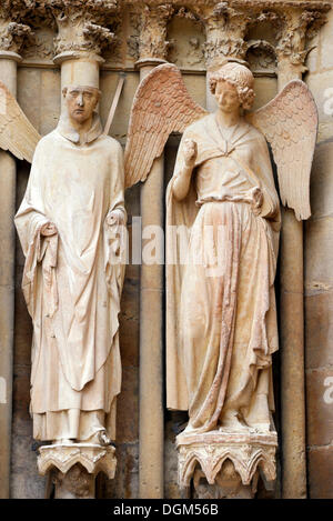 Statues, on the right the 'friendly angel', left portal, west façade, Cathedral of Notre-Dame, Unesco World Heritage - Stock Photo
