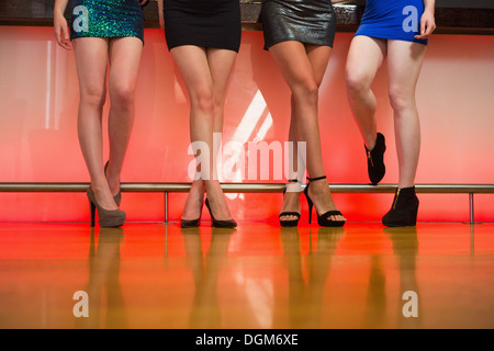 Young women legs posing - Stock Photo