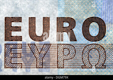 Security features of banknotes, 20 euro bill, raised print, value numbers in window, lettering EURO - Stock Photo