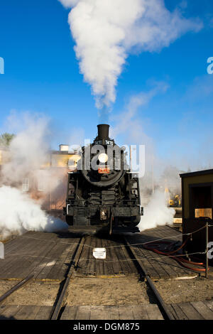 Old steam locomotive, 7470 model, driving in front of the heating house, Conway Scenic Railroad in Conway, New Hampshire, - Stock Photo