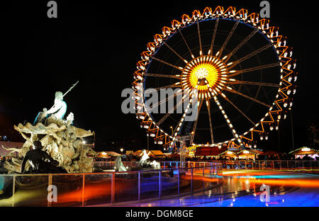 Ferris wheel at the Christmas market in front of the Neptunbrunnen fountain, Alexanderplatz, Berlin - Stock Photo