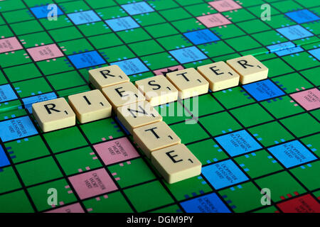 Scrabble letters forming the words Riester and Rente, German for the Riester pension - Stock Photo