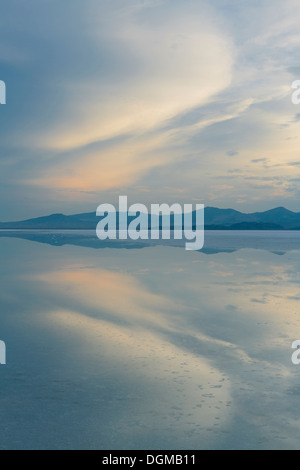 Shallow water over the surface at the Bonneville Salt Flats near Wendover, at dusk. - Stock Photo