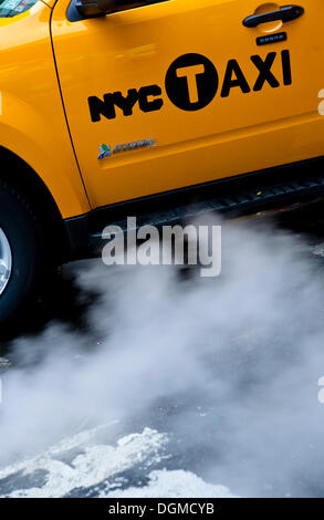 Steam surrounding a taxi, New York City, USA - Stock Photo