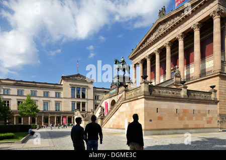 Berlin, Germany, passers-by in front of the Old National Gallery on Museum Island - Stock Photo
