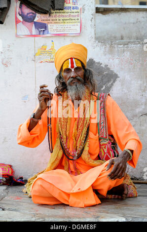 Sadhu, holy man, in front of the Jagdish temple in Udaipur, Rajasthan, North India, India, South Asia, Asia - Stock Photo