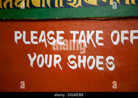Please take off your's shoes sign in Temple at Boudha (Bodhnath) (Boudhanath) in Kathmandu, Nepal, Asia - Stock Photo