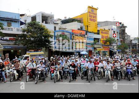 Moped riders, Ho Chi Minh City, Saigon, South Vietnam, Vietnam, Southeast Asia, Asia - Stock Photo