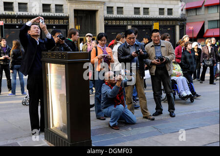Tourists taking pictures of Rockefeller Center, Manhattan, New York City, New York, United States of America, USA, - Stock Photo