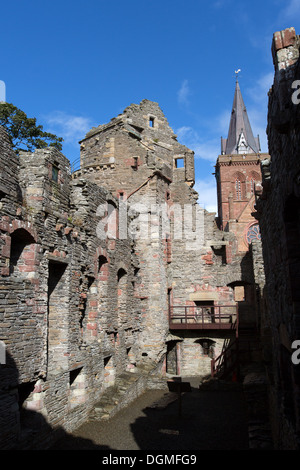 Islands of Orkney, Scotland. Kirkwall's Bishops Palace, with the spire of St Magnus Cathedral in the background. - Stock Photo