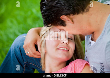 Man holding his wife tenderly in his arms - Stock Photo