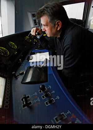 Wolfgang Weckerle, a train driver driving a double-decker 146 series locomotive on a regional express train from - Stock Photo