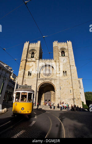 Yellow tram in front of the Sé Cathedral or Catedral Sé Patriarcal, Lisbon, Portugal, Europe - Stock Photo