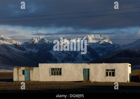 Residential house in the morning light in Alichur on the Pamir Highway M41, Pamir, Tajikistan, Central Asia, Asia - Stock Photo
