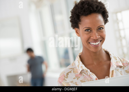Business people. A woman using a digital tablet. - Stock Photo