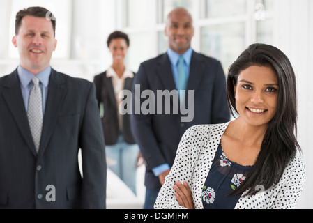 Business people. A team of people, a department or company. Two men and two woman. - Stock Photo