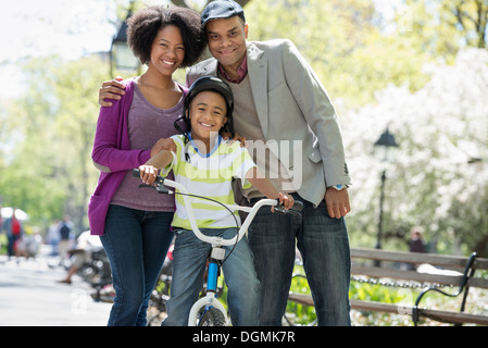 A family in the park on a sunny day. - Stock Photo