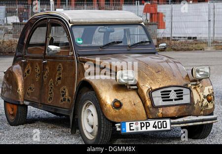 Cult car Citroen 2CV Duck, gold painted body, Essen, North Rhine-Westphalia - Stock Photo