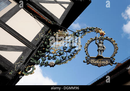 Ornamental sign of the Roland Café, Breite Strasse Street, Quedlinburg, Harz, Saxony-Anhalt - Stock Photo