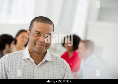 Business meeting. A man smiling confidently. - Stock Photo