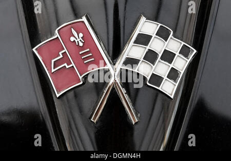 Old Chevrolet Corvette logo, crossed flags, an American sports car from General Motors - Stock Photo