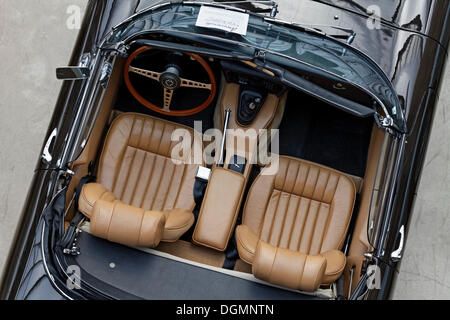 Open roadster, two beige leather seats, Jaguar E-Type, British vintage car - Stock Photo