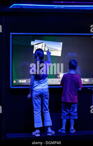 Children controlling software by touch and gestures, touch screen, Ideenpark 2012, technology and education summit - Stock Photo