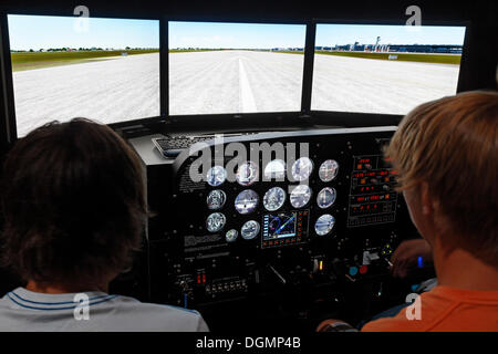 Teenagers as pilots in a Prop Cockpit Trainer, flight simulator, IdeenPark 2012, technology and education summit - Stock Photo