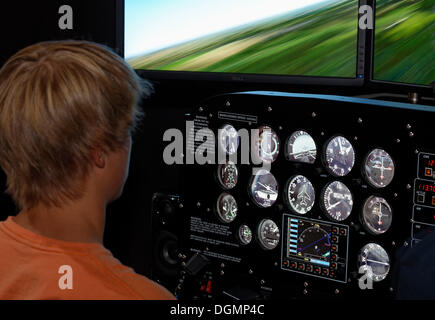 Boy as a pilot in a Prop Cockpit Trainer, flight simulator, IdeenPark 2012, technology and education summit conference - Stock Photo