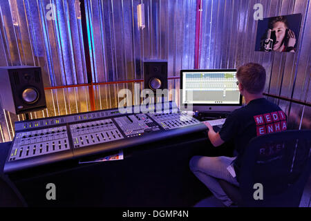 Sound engineer at the mixing desk in a recording studio, music production demonstration of the SAE Institute, IdeenPark - Stock Photo