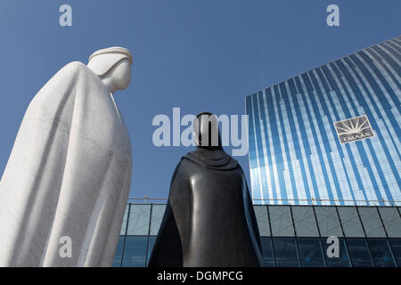 Sculpture of an Arab man and an Arab woman in front of the EMAAR building, Dubai, United Arab Emirates, Middle East, Asia