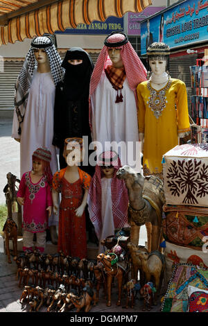 Mannequins wearing traditional Arabic clothing for sale, for women, men and children, Deira, Old Souk, Dubai - Stock Photo