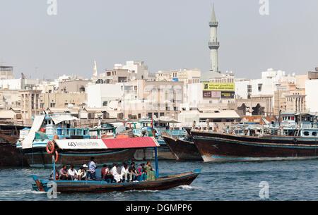 Abra, traditional water taxis on Dubai Creek, overlooking the Deira district, Dubai, United Arab Emirates, Middle - Stock Photo