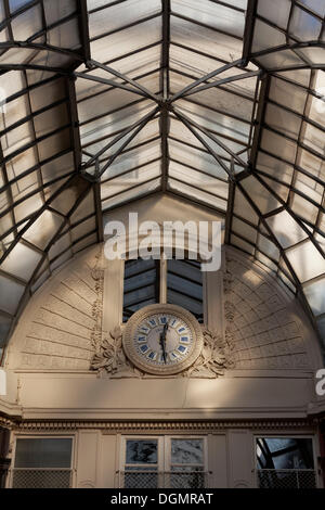 Passage Jouffroy, a historic covered shopping arcade of 1846, with the historic clock, Grands Boulevards, 2nd Arrondissement - Stock Photo