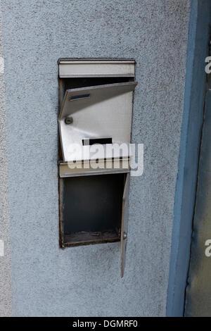 Broken letterbox, derelict residential house - Stock Photo