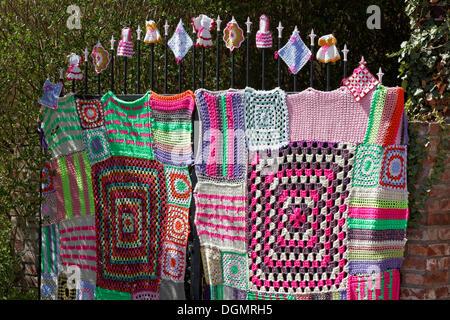 Knitted iron gate with Granny Square pattern, guerrilla knitting, knit art, graffiti knitting, street art, Düsseldorf - Stock Photo
