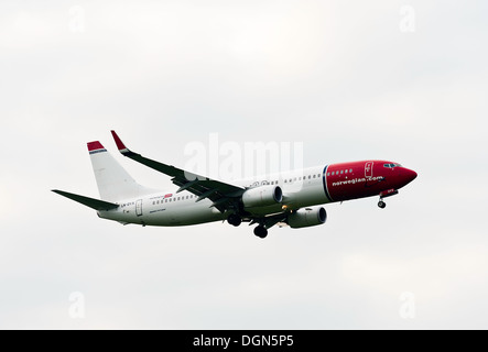 Norwegian Air Shuttle Boeing 737 Airliner on Approach for Landing at London Gatwick Airport West Sussex England - Stock Photo