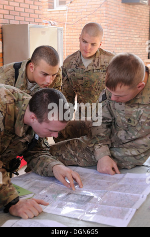 Soldiers from Company A, 2nd Battalion, 4th Infantry Regiment, learn how to read a map and navigate terrain during - Stock Photo