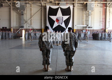 The commander of 4th Attack Reconnaissance Squadron, 6th Cavalry Regiment, Lt. Col. Brian Watkins, salutes the commander - Stock Photo
