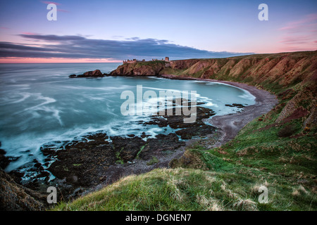 Beach with castle ruins in the background - Stock Photo
