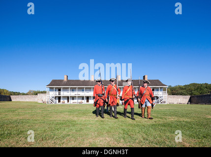 Historic 18th century daily life in Fort Frederick Maryland. Volunteers march with period uniforms and muskets. - Stock Photo