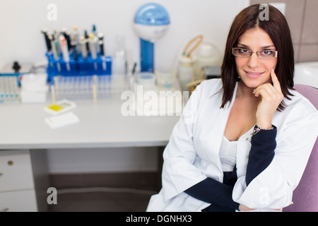 Young woman in modern medical laboratory - Stock Photo