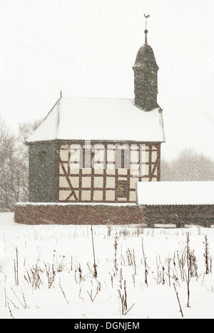 Small village church in the thick snow, winter, winter in Hessenpark, Neu-Anspach, Taunus, Hesse - Stock Photo