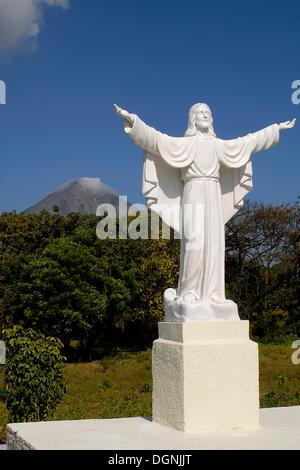 Jesus statue in front of volcano Mt. Concepcion, Isla de Ometepe, Nicaragua, Central America - Stock Photo