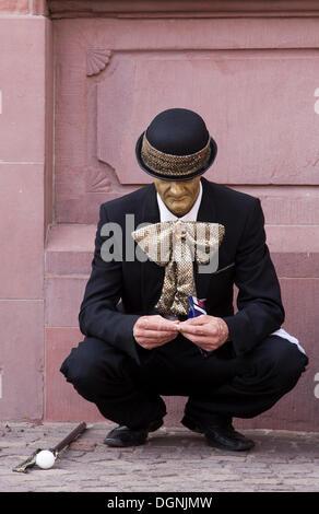 Street performer during a break, Frankfurt am Main, Hesse - Stock Photo